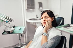 Woman with toothache at dentist's