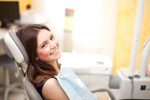 woman in dentist chair smiling